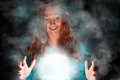 Witch woman young smiling making magic misty background Stock Photo