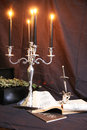 Witchcraft items for old books pentacle and candles Stock Image