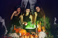 Witches brew the potion three beautiful in boiler Royalty Free Stock Photo