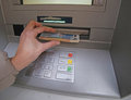 Withdrawal of money in european banknotes from automatic cash ma atm Royalty Free Stock Photo