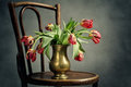 Withered tulips retro still life with in metal vase Royalty Free Stock Photo