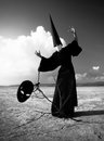 Wizard with the black mask in desert Stock Photo