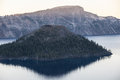 Wizard island and crater lake is a volcanic cinder cone that is found in national park this is the deepest in the united states Stock Photography