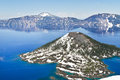 Wizard island points east in crater lake to the rim Stock Photography