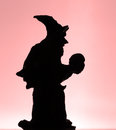 Wizard with a scull silhouette of or witch Stock Photo