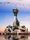Wizards tower fantasy sitting on a rock island with sunset background Stock Photo