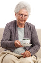 Wold woman sick cup of tea with a in her hand cut on white background Stock Images