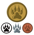 Wolf paw logo a icon in a golden colour on a circle Royalty Free Stock Image