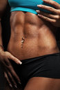 Woman abdominal muscles beautiful closeup on black background Stock Image