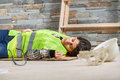 Woman in accident at workplace construction worker an Stock Photography