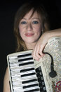 Woman with accordion young playing the Royalty Free Stock Images