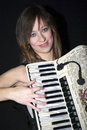 Woman with accordion young playing the Stock Photos