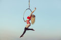 Woman acrobat in the air. Royalty Free Stock Photo