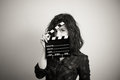 Woman actress eyes portrait behind movie clapper board Royalty Free Stock Photo
