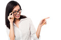 Woman adjusting her spectacles and pointing away young lady eyeglasses Royalty Free Stock Photography