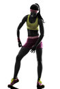 Woman adjusting sportswear silhouette one exercising fitness in on white background Royalty Free Stock Images
