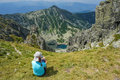 Woman admiring mountain lake in romania Stock Photo