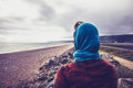 Woman admiring the sea on a cold autumn day rear view of young Royalty Free Stock Image