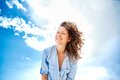 Woman against blue sky Royalty Free Stock Photo