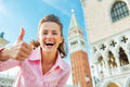 Woman against campanile di san marco in venice happy young showing thumbs up italy Royalty Free Stock Photos