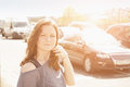 Woman against traffic young brunette standing in sunlight Royalty Free Stock Photo