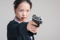 Woman aiming a hand gun close up portrait of in business suit Royalty Free Stock Image