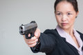 Woman aiming a hand gun close up portrait of in business suit Stock Image