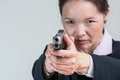 Woman aiming a hand gun close up portrait of in business suit at you Royalty Free Stock Photography