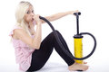 Woman with air pump Royalty Free Stock Photo
