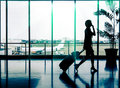 Woman at airport silhouette of a passenger business female Stock Photo