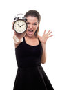 Woman with alarm clock screaming angry late isolated on white Stock Photography