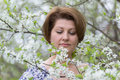 Woman with allergic rhinitis in spring garden the Royalty Free Stock Images