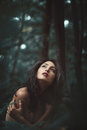 Woman alone in peaceful forest