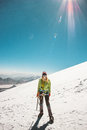 Woman alpinist climbing in high mountains glacier Royalty Free Stock Photo