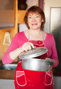 Woman with aluminium saucepan Royalty Free Stock Photography