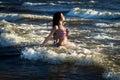 Woman in in american flag bikini in water, sea, waves. Fashion. Royalty Free Stock Photo
