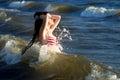Woman in in american flag bikini in water, sea, waves. Fashion Royalty Free Stock Photo