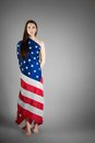 Woman in the american flag on gray background Stock Photos