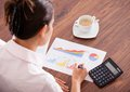 Woman analyzing the financial data close up of female hand with calculator Royalty Free Stock Photos
