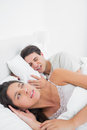 Woman annoyed that her partner snoring in bed Stock Photo