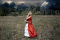 Woman in antique red dress Royalty Free Stock Photo