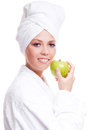 Woman with an apple Royalty Free Stock Photography