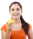 Young teenage girl holding apple Royalty Free Stock Photo