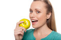 Woman with apple beautiful young eating and smiling to you while isolated on white Royalty Free Stock Images