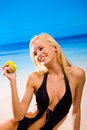 Woman with apple in bikini Stock Photos