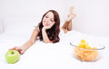Woman with apple and chips Stock Images