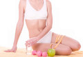Woman with apple, dumbbells and water Stock Photo