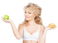 Woman with apple and hamburger health beauty weightloss food diet concept sporty Royalty Free Stock Photos