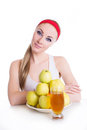 Woman with apple juice and fruits Royalty Free Stock Photo