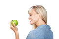 Woman with apple side view shot of holding and looking on the green Royalty Free Stock Photography